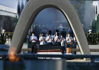 People pray at the cenotaph for atomic bomb victims at the Hiroshima Peace Memorial Park in Hiroshima on Aug. 6, 2021. (Mainichi/Naohiro Yamada)