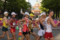 Dawid Tomala, of Poland, right, and others competes during the men's 50km race walk at the 2020 Summer Olympics, on Aug. 6, 2021, in Sapporo, Japan. (AP Photo/Shuji Kajiyama)
