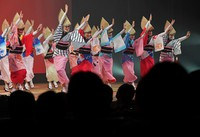 Events ahead of the start of the Awa Odori Dance Festival for the first time in two years are seen in Tokushima City on August 12, 2021. Dancers on a hall stage performed in front of members of the public in widely spaced seats.  (Mainichi / Naohiro Yamada)