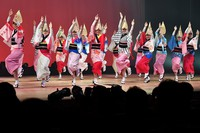 A performance of the Awa Odori dance festival takes place for the first time on a hall stage as part of the coronavirus prevention measures, in the city of Tokushima on August 12, 2021, the day before the main event.  Some dancers wore face shields.  (Mainichi / Naohiro Yamada)