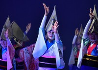 Dancers wearing face shields perform on August 12, 2021, ahead of the main events of the Awa Odori Dance Festival in Tokushima City.  The dances are taking place for the first time on the stages of the hall as part of the coronavirus prevention measures.  (Mainichi / Naohiro Yamada)