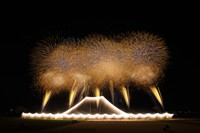 A scene of the 44th Edogawa Fireworks Festival in 2019 is shown in this image provided by Tokyo's Edogawa Ward. In this display, some of the fireworks were attached to wire suspended in the air at a height of 50 meters to create a waterfall effect to portray Mount Fuji. Above this, at a height of 220 meters, large fireworks went off across a range spanning about 300 meters, in sync with the music that played in the background. The 2019 Edogawa Fireworks Festival can be watched via the link https://youtu.be/o19fMOZ9zp4