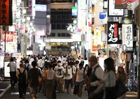 A street in Shinjuku's Kabukicho district is seen bustling with people even after 8 p.m., in this photo taken in Tokyo on Aug. 11, 2021. (Mainichi/Kota Yoshida)