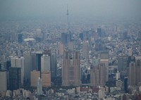 The Tokyo Metropolitan Government building, center, and other high-rise buildings in Shinjuku Ward are seen in this aerial photo taken from a Mainichi Shimbun helicopter in April 2020. (Mainichi/Kota Yoshida)