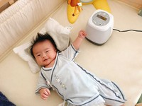 """This photo provided by parents from Chiba Prefecture shows a prototype of """"ainenne,"""" a device that uses artificial intelligence to estimate why a baby is crying, in use."""