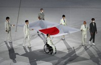 A Japanese national flag is carried during the opening ceremony of the Summer Paralympic Games at the Japan National Stadium in Tokyo's Shinjuku Ward on Aug. 24, 2021. (Mainichi/Rei Kubo)