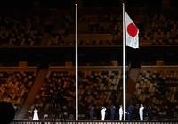 Hirari Sato, left, sings Japan's national anthem during the opening ceremony of the Summer Paralympic Games, at the Japan National Stadium in Tokyo's Shinjuku Ward on Aug. 24, 2021. (Mainichi/Toshiki Miyama)