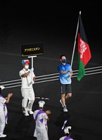 The national flag of Afghanistan is carried during the opening ceremony of the Summer Paralympic Games, at the Japan National Stadium in Tokyo's Shinjuku Ward on Aug. 24, 2021. (Mainichi/Noriko Tokuno)