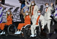 Members of the Dutch delegation enter the venue during the opening ceremony of the Summer Paralympic Games, at the Japan National Stadium in Tokyo's Shinjuku Ward on Aug. 24, 2021. (Mainichi/Toshiki Miyama)