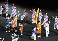 Members of the Bhutanese delegation, clad in ethnic attire, enter the venue during the opening ceremony of the Summer Paralympic Games, at the Japan National Stadium in Tokyo's Shinjuku Ward on Aug. 24, 2021. (Mainichi/Kentaro Ikushima)