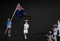 The national flag of New Zealand is carried during the opening ceremony of the Summer Paralympic Games, at the Japan National Stadium in Tokyo's Shinjuku Ward on Aug. 24, 2021. The country's delegates were absent as a measure to prevent coronavirus infections. (Mainichi/Noriko Tokuno)