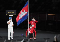 Members of the Cambodian delegation enter the venue during the opening ceremony of the Summer Paralympic Games, at the Japan National Stadium in Tokyo's Shinjuku Ward on Aug. 24, 2021. (Mainichi/Toshiki Miyama)