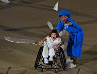 Yui Wago, left, plays the role of a single-winged plane during the opening ceremony of the Summer Paralympic Games, at the Japan National Stadium in Tokyo's Shinjuku Ward on Aug. 24, 2021. (Mainichi/Noriko Tokuno)