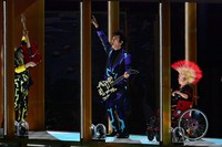 Japanese musician Tomoyasu Hotei, center, plays the guitar during the opening ceremony of the Summer Paralympic Games at the Japan National Stadium in Tokyo's Shinjuku Ward on Aug. 24, 2021. (Mainichi/Tatsuya Fujii)