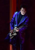 Japanese musician Tomoyasu Hotei plays the guitar during the opening ceremony of the Summer Paralympic Games at the Japan National Stadium in Tokyo's Shinjuku Ward on Aug. 24, 2021. (Mainichi/Tatsuya Fujii)