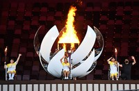 Japanese athletes Yui Kamiji, center, Shunsuke Uchida, right, and Karin Morisaki wave after lighting the Paralympic cauldron during the opening ceremony for the Tokyo Paralympic Games at the Japan National Stadium in Tokyo, on Aug. 24, 2021. (Mainichi/Toshiki Miyama)