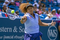 Naomi Osaka of Japan hits the ball to Cori Gauff of the United States during the Western & Southern Open tennis tournament at the Lindner Family Tennis Center, Wednesday, Aug. 18, 2021 in Mason, Ohio. (Cara Owsley/The Cincinnati Enquirer via AP)