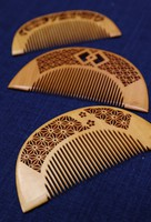 Decorative combs with beautiful wood carvings that serve as hair accessories are seen at traditional boxwood comb shop Yonoya Kushiho in Tokyo's Taito Ward on July 12, 2021. (Mainichi/Junichi Sasaki)