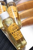 Camellia oil products sold at traditional boxwood comb shop Yonoya Kushiho are seen in Tokyo's Taito Ward on July 12, 2021. (Mainichi/Junichi Sasaki)