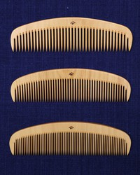 """Three types of """"brushing combs"""" -- the main products of Yonoya Kushiho which can be run through the hair smoothly to a remarkable extent -- are seen at traditional boxwood comb shop Yonoya Kushiho in Tokyo's Taito Ward on July 12, 2021. Customers can choose from three types whose teeth are spaced apart at different widths, based on the nature of their hair. (Mainichi/Junichi Sasaki) =Click/tap photo for more images."""