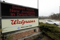 In this March 27, 2020, file photo, a Walgreens sign is displayed outside the store in Wheeling, Ill. (AP Photo/Nam Y. Huh, File)