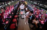 Coronavirus vaccines are administered at a parlor where pachinko and slot machines are lined up, in Osaka's Kita Ward on Sept. 14, 2021. (Mainichi/Naohiro Yamada)