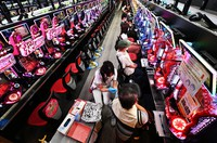 Coronavirus vaccines are administered at a parlor where pachinko and slot machines are lined up, in Osaka's Kita Ward on Sept. 14, 2021. (Mainichi/Naohiro Yamada)=Click/tap photo for more images.