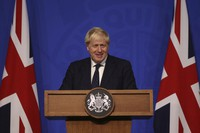 Britain's Prime Minister Boris Johnson attends a media briefing at 10 Downing Street in London, on Sept. 14, 2021. (Dan Kitwood/Pool Photo via AP)