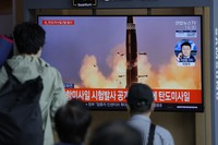 People watch a TV screen showing a news program reporting on North Korea's missiles with a file image in Seoul, South Korea, on Sept. 15, 2021. (AP Photo/Lee Jin-man)