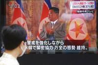 A man walks past a TV screen showing North Korean leader Kim Jong Un, in Tokyo, on Sept. 15, 2021. (AP Photo/Koji Sasahara)