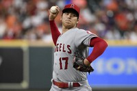 Los Angeles Angels starting pitcher Shohei Ohtani delivers during the first inning of a baseball game against the Houston Astros on Sept. 10, 2021, in Houston. (AP Photo/Eric Christian Smith)