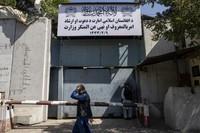 An Afghan man walks past the former Women's Affairs Ministry building in Kabul, Afghanistan, Saturday, Sept. 18, 2021. (AP Photo/Bernat Armangue)