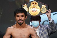 In this Aug. 20, 2021, file photo, Manny Pacquiao, of the Philippines, poses for photographers during a weigh-in in Las Vegas. (AP Photo/John Locher, File)