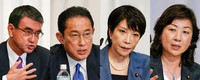 A combination of photos of candidates of the ruling Liberal Democratic Party for the upcoming presidential election speaks during a joint news conference at the party's headquarters in Tokyo, Sept. 17, 2021. (Kimimasa Mayama/Pool Photo via AP)