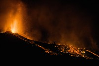 Lava flows from an eruption of a volcano at the island of La Palma in the Canaries, Spain, on Sept. 19, 2021. (AP Photo/Jonathan Rodriguez)