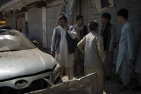 Afghans gather at the site of an explosion in Kabul, Afghanistan, on Sept. 18, 2021. (AP Photo/Felipe Dana)