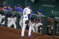 Texas Rangers starting pitcher Kohei Arihara (35) leaves the field after turning the ball over in the fifth inning of a baseball game against the Houston Astros in Arlington, Texas, on Sept. 15, 2021. (AP Photo/Tony Gutierrez)