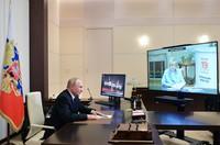 Russian President Vladimir Putin speaks to Ella Pamfilova, head of Russian Central Election Commission, on the screen, during their meeting via video conference at the Novo-Ogaryovo residence outside Moscow, on Sept. 20, 2021. (Alexei Druzhinin, Sputnik, Kremlin Pool Photo via AP)