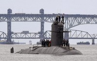 In this photo provided by U.S. Navy, French submarine FNS Amethyste (S605) transits the Thames River in preparation to arrive at Naval Submarine Base New London in Groton, Connecticut, on Sept. 1, 2021. (Chief Mass Communication Specialist Joshua Karsten/U.S. Navy via AP)