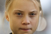 In this Jan. 24, 2020 file photo, Swedish climate activist Greta Thunberg poses for media as she arrives for a news conference in Davos, Switzerland. (AP Photo/Markus Schreiber)