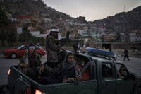 Taliban fighters sit on the back of a pickup truck as they stop on a hillside in Kabul, Afghanistan, on Sept. 19, 2021. (AP Photo/Felipe Dana)