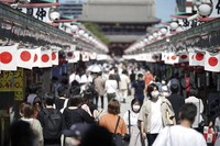 Visitors wearing protective masks to help curb the spread of the coronavirus stroll at Sensoji Temple in the Asakusa district in Tokyo on Sept. 20, 2021. (AP Photo/Eugene Hoshiko)