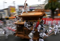 A float is pulled through the downtown area during the Kishiwada Danjiri Festival, held for the first time in two years, in Kishiwada, Osaka Prefecture, on Sept. 18, 2021. (Mainichi/Rei Kubo)