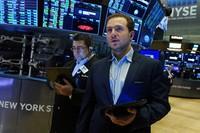 Trader Ben Tuchman, right, works on the floor of the New York Stock Exchange, on Sept. 21, 2021. (AP Photo/Richard Drew)