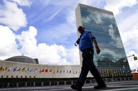 A member of the FDNY passes outside the United Nations headquarters, on Sept. 21, 2021, during the 76th Session of the U.N. General Assembly in New York. (AP Photo/John Minchillo, Pool)