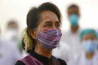 In this Jan 27, 2021, file photo, Myanmar leader Aung San Suu Kyi watches the vaccination of health workers at a hospital in Naypyitaw, Myanmar. (AP Photo/Aung Shine Oo)