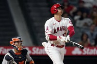 Los Angeles Angels' Shohei Ohtani follows through on his solo home run during the eighth inning of a baseball game against the Houston Astros on Sept. 21, 2021, in Anaheim, Calif. (AP Photo/Marcio Jose Sanchez)