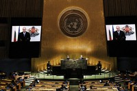 Bulgaria's President Rumen Radev is seen on video screens as he addresses the 76th Session of the United Nations General Assembly remotely, on Sept. 21, 2021 at U.N. headquarters. (Spencer Platt/Pool Photo via AP)