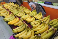 Taiwanese bananas for sale are on display at a fruit stall in Taipei, Taiwan, on Sept. 20, 2021. (AP Photo/Chiang Ying-ying)