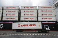 In this Dec. 15, 2008, file photo, a Taiwanese shipping company loads containers on a ship in the harbor of Keelung, Taiwan. (AP Photo/Wally Santana)